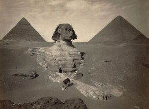The-Sphinx-of-Giza-partially-excavated-with-two-pyramids-in-background-Egypt-1867-1899