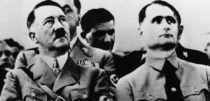 circa 1939: Adolf Hitler (1889 - 1945) with his deputy and private secretary, Rudolf Hess (1894 - 1987) at a Nazi Party meeting. (Photo by Keystone/Getty Images)